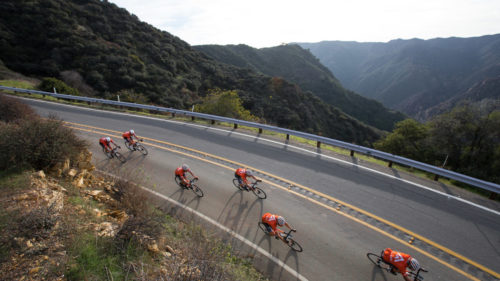 The team rounded the Malibu Canyon Overlook on the way back home. Though they'd been riding since eleven, they wouldn't reach the house until sunset.
